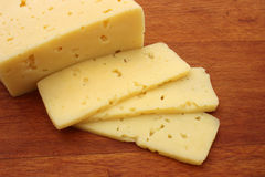 Piece of cheese and slices Stock Photo