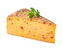 Piece of cheese with spices Royalty Free Stock Photography