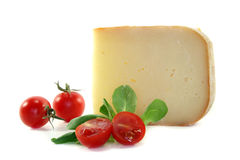 Piece of cheese with tomatoes Royalty Free Stock Photography