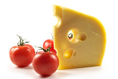 Piece of cheese and tomatoes Stock Image