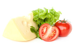 Piece of cheese, tomatoes and salad. On white background royalty free stock photography