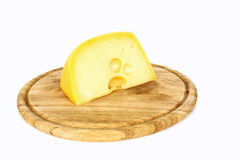 Piece of cheese on wooden board. Cutout stock photos