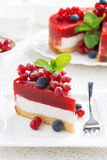 Piece of cheesecake with berry jelly, vertical Stock Photo