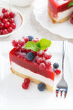 piece of cheesecake with berry jelly on a white plate, top view Stock Images