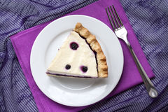 Piece of cheesecake with blueberries on a plate Stock Image