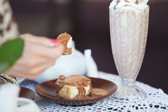 Piece of cheesecake in cafe Stock Image