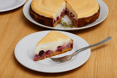 Piece of cheesecake with cherry and meringue Stock Photo