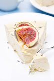 Piece of cheesecake with honey and lavender, fresh figs, close-up Stock Photography