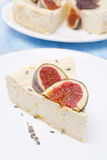 Piece of cheesecake with honey and lavender and fresh figs Stock Photography