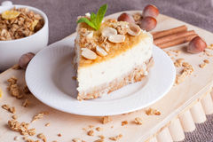 Piece of cheesecake with nut on wooden board Royalty Free Stock Photography