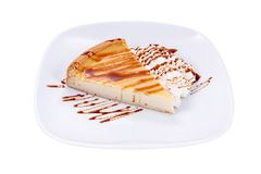 Piece of cheesecake. Over white background Stock Photo