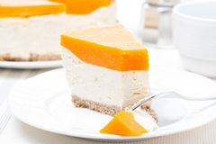 Piece of cheesecake with pumpkin jelly on the plate Stock Photo
