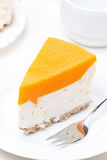 Piece of cheesecake with pumpkin jelly, top view Stock Photography