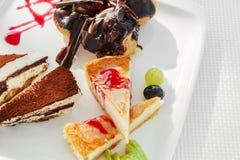 Piece of cheesecake and tiramisu Royalty Free Stock Photo