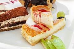 Piece of cheesecake and tiramisu Royalty Free Stock Photos