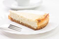 Piece of cheesecake on white plate Royalty Free Stock Photos