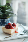 A piece of cherry cheesecake and black coffee Stock Images