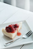 A piece of cherry cheesecake Stock Image