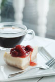 A piece of cherry cheesecake Stock Photos