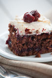 Piece of cherry and meringue cake Stock Images