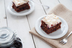 Piece of cherry and meringue cake Stock Photos