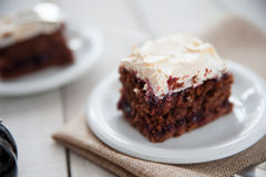 Piece of cherry and meringue cake Stock Image