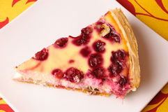 A piece of cherry pie. On a white saucer Stock Photo