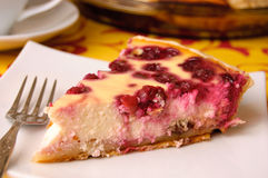 A piece of cherry pie. On a white saucer Royalty Free Stock Images