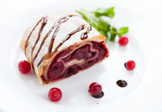 Piece of cherry pie with cranberries on a white plate Royalty Free Stock Photo