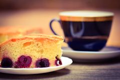 Piece of cherry pie and cup of tea Royalty Free Stock Photo