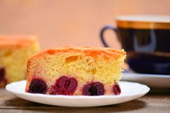 Piece of cherry pie and cup of tea Royalty Free Stock Photography