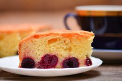 Piece of cherry pie and cup of tea Stock Image
