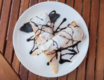 Piece of cherry strudel with chocolate. Royalty Free Stock Photography