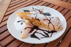 Piece of cherry strudel with chocolate. Royalty Free Stock Images