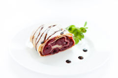 Piece of cherry strudel on a white plate Royalty Free Stock Photography