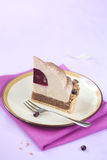 Piece of Chestnut and Blackcurrant Entremet Cake Royalty Free Stock Photos