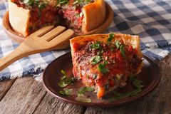 Piece of Chicago deep dish pizza closeup on a plate. horizontal Royalty Free Stock Photography