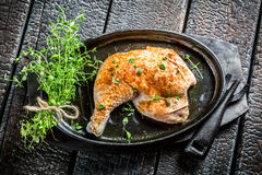 Piece of chicken with herbs and spices ready to grill Stock Photo