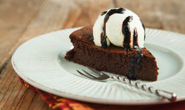 Piece of chocolate almond cornmeal cake with balsamic drizzle Royalty Free Stock Photo