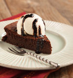 Piece of chocolate almond cornmeal cake with balsamic drizzle. And ice cream Royalty Free Stock Photo
