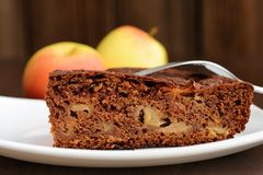 Piece of chocolate apple cake and apples Stock Photo