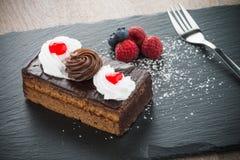 Piece of chocolate cake Royalty Free Stock Photos