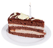 Piece of chocolate cake with burning candle Royalty Free Stock Photos