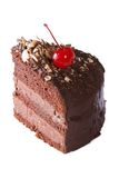 Piece chocolate cake with cherry closeup isolated on white Royalty Free Stock Photography