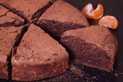Piece of chocolate cake, close-up. Piece of chocolate cake with mandarins, close-up Royalty Free Stock Images