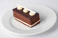 Piece of chocolate cake. With creame icing Royalty Free Stock Images