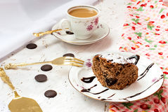 Piece of chocolate cake and a cup of coffee with milk Royalty Free Stock Photography
