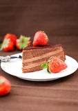Piece of chocolate cake decorated with fresh strawberry Stock Photography
