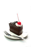 Piece of chocolate cake and fork with white background Royalty Free Stock Photos