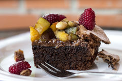 A piece of chocolate cake with fresh fruits Royalty Free Stock Image
